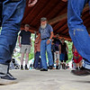 Dennis Rhodes, a prominent flatfoot dancer from Kentucky, demonstrates his style during the Flatfoot Dance Workshop at the 2018 Appalachian String Band Festival in Clifftop Wednesday. (Chris Jackson/The Register-Herald)