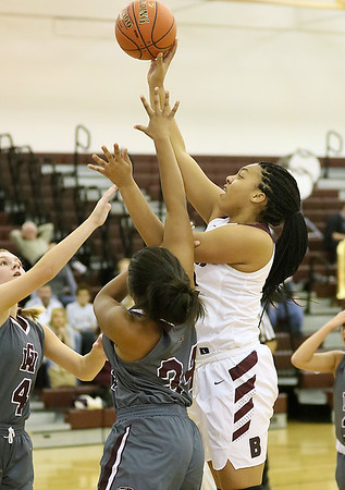 (Brad Davis/The Register-Herald) Woodrow Wilson's Jamara Walton scores as George Washington's Naveah Harman, right, and Lauren Harmison, left, defend Thursday night in Beckley.