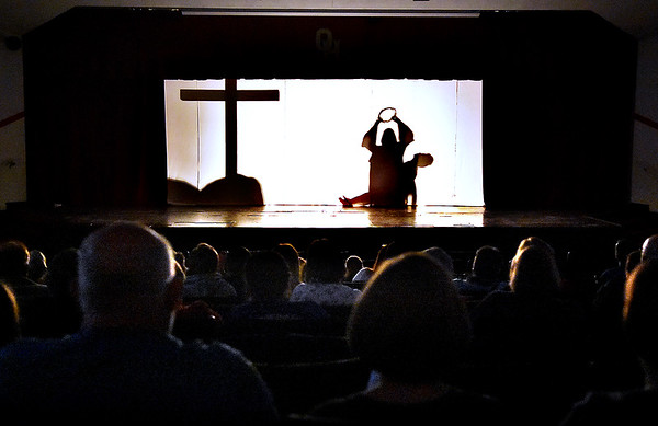 (Brad Davis/The Register-Herald) Young actors from the Catholic Youth Group of Saints Peter and Paul Catholic Church perform dramatic scenes behind a backlit curtain in The Living Stations of the Cross in Silhouette Sunday afternoon inside the Oak Hill High School Auditorium