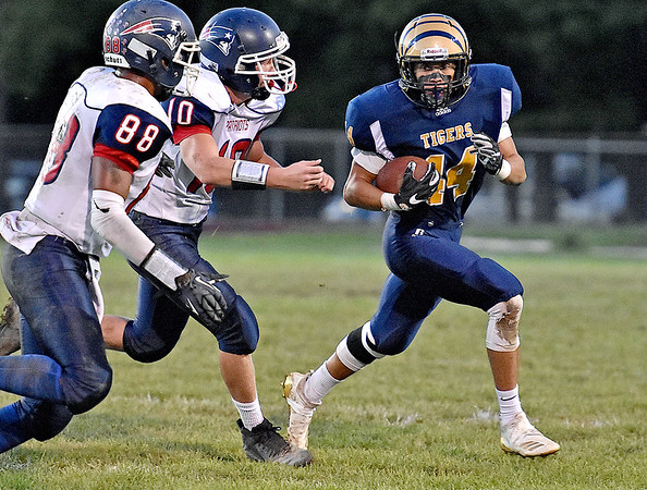 (Brad Davis/The Register-Herald) Shady Spring's Isaiah Valentine carries the ball as Independence defenders Niko Burgess, left, and Andrew Martin give chase Thursday night in Shady Spring.
