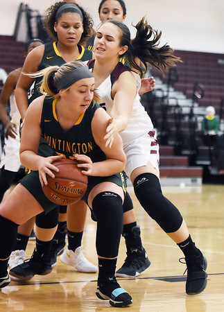 Woodrow Wilson's Madison Miller (40) tries to get the ball back from Huntington's (32) after losing it during their basketball game Tuesday in Beckley. (Chris Jackson/The Register-Herald)