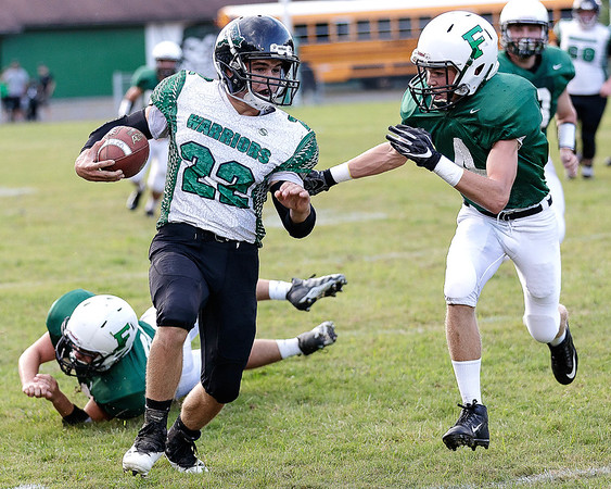 Eli Selvey of Fayetteville attempts to force Caleb Bower of Wyoming East out of bounds. Chad Foreman for the Register-Herlad.