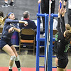 (Brad Davis/The Register-Herald) Nicholas County's Meaghan Willis spikes the ball through a pair of Winfield defenders during State Volleyball Tournament action Friday afternoon at the Charleston Civic Center.