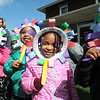 Makayla Harbin, left, Alaha Collier, Tayla Walker and Kyn-Lee Lowe, pre-school students at Raleigh County Head Start, placed paper pinwheels over their faces during a program held in front of the Mayors office on South Kanawha Street. Rob Rappold, the Mayor of Beckley, proclaimed April Child Abuse Prevention Month for the City of Beckley.  Just For Kids Child Advocacy Center organized the 5th Annual Plant a Pinwheel for Prevention event on the Mayor's lawn.  Over 30 children from the Raleigh County Head Start Center came and helped the Mayor and two Deputies from the Sheriff's Dept. plant pinwheels.<br /> (Rick Barbero/The Register-Herald)