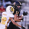 Summers County's Keandre Sarver (11) carries the ball after a catch as Mount View's Jasauni Sizemore (12) chases during their high school football game Thursday in Hinton. (Chris Jackson/The Register-Herald)