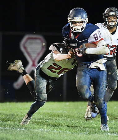Kaleb Cox, of Independence, right, breaks away from Nathaniel Gordan, of Liberty, during first half action at Independence High School Friday night.<br /> (Rick Barbero/The Register-Herald