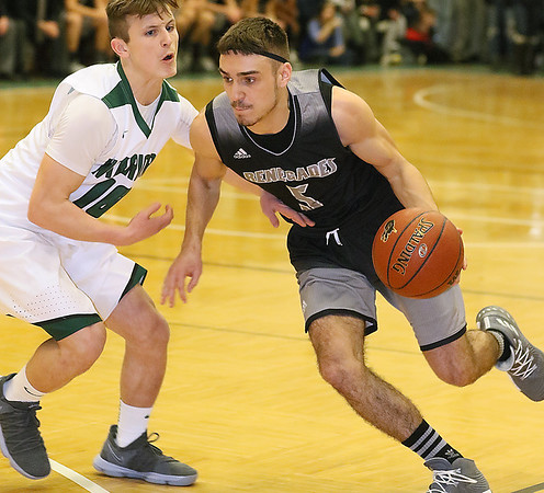 (Brad Davis/The Register-Herald) Westside's Shane Jenkins speeds past Wyoming East defender Chase York Saturday night in New Richmond.