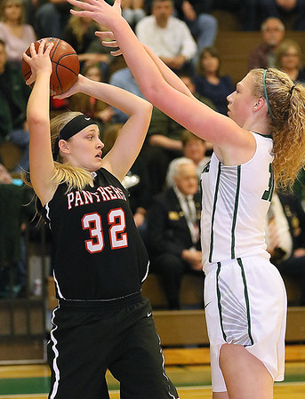 (Brad Davis/The Register-Herald) PikeView's Laken McKinney looks for an open teammate as Wyoming East defender Emily Saunders converges on her Thursday night in New Richmond.