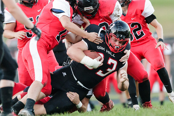 It takes 5 Pikeview defenders to bring down Oak Hill's Logan Lawhorn. Chad Foreman for the Register Herald.