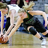 (Brad Davis/The Register-Herald) Wyoming East senior Misa Quesenberry tries to make a defensive stop late as she rushes in to steal the ball from North Marion's Hannah Shriver Saturday afternoon at the Charleston Civic Center.