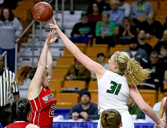 (Brad Davis/The Register-Herald) Wyoming East's Emily Saunders blocks a  jump shot attempt by Wayne's Nakayla Elliot Friday morning at the Charleston Civic Center.
