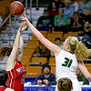(Brad Davis/The Register-Herald) Wyoming East's Emily Saunders blocks a  jump shot attempt by Wayne's Nakayla Elliot Friday morning at the Charleston Civic Center.
