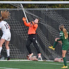 (Brad Davis/The Register-Herald) George Washington's Chloe Shack (#15) maybe gets a piece of it as a shot off a last second free kick through traffic finds its way past Greenbrier East goalkeep Mallory Alderson for the game's only goal just beofre the half Thursday evening at the YMCA Paul Cline Memorial Sports Complex.