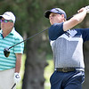 (Brad Davis/The Register-Herald) Sam O'Dell watches his tee shot on 17 as groupmates Pat Carter, left, and Ben Palmer look on during third round action at the West Virginia Amateur Wednesday afternoon on the Greenbrier's Meadows Course.