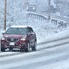 (Brad Davis/The Register-Herald) Motorists tread carefully along a section of Pikeview Drive as the snow begins to accumulate Saturday afternoon.