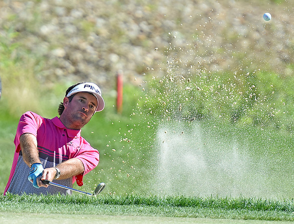 (Brad Davis/The Register-Herald) Bubba Watson chips out of a bunker on 15 during the Military Tribute at The Greenbrier Sunday afternoon in White Sulphur Springs.