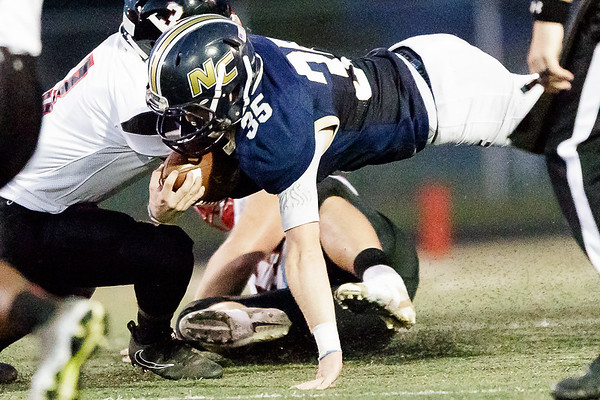 Nicholas County Grizzly, Jacob O'Dell dives forward for a few more yards. Chad Foreman for the Register-Herald.