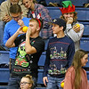 (Brad Davis/The Register-Herald) Festive Nicholas County students cheer on their classmates on the court dressed in their finest Christmas garb during the Grizzlies' home game against Independence Friday night in Summersville.