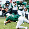 Fayetteville's Jordan Dempsey wraps Wyoming East's Caleb Bower mid-stride. Chad Foreman for the Register-Herlad.