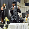 (Brad Davis/The Register-Herald) Graduating Westside senior John Simpson strikes a pose towards fellow classmates as he's called to receive his diploma during the school's 2018 Commencement Ceremony Sunday afternoon in Clear Fork.