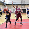 (Brad Davis/The Register-Herald) WV Thunder's (Huntington) Sienna Allen drives to the basket as Beckley White's Donya Burton (#3) defends during a fourth grade Biddy Buddy Tournament game Friday afternoon at the YMCA of Southern West Virginia. WV Thunder won the game by a wide margin.