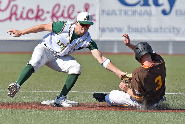 (Brad Davis/The Register-Herald) Miners shortstop Maddux Houghton reaches over to tag out stealing Kokomo baserunner Ian Walters at 2nd during a loss to the Jackrabbits Sunday afternoon at Linda K. Epling Stadium.