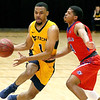 (Brad Davis/The Register-Herald) WVU Tech's Brandon Shingles drives across mid-court as Bluefield State's Shawn Robinson defends Wednesday night at the Beckley-Raleigh County Convention Center.