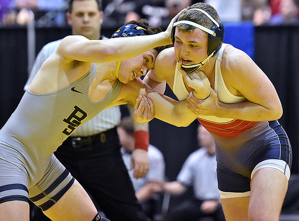 (Brad Davis/The Register-Herald) Independence's Haegan takes on Berkeley Springs' Davy Mundey for the Class A/AA 152-pound weight class championship during State Wrestling Tournament action Saturday night at the Big Sandy Arena. Harvey lost to Mundey.