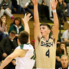 (Brad Davis/The Register-Herald) Shady Spring's Ryan Riffe Shoots from three-point range as Wyoming East's Zach Brown defends Friday night in New Richmond.