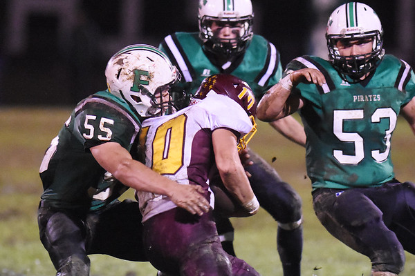 Fayettevill'es Jude Browning (55) tackles Sherman's  Seth Rinchich (10) during their high school football game Friday in Fayetteville. (Chris Jackson/The Register-Herald)