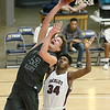 (Brad Davis/The Register-Herald) Wyoming East's Anthony Martin drives to the basket as Woodrow Wilson's Jonah Stevens defends during the Little General Battle for the Armory Tournament Friday night at Beckley-Raleigh County Convention Center.