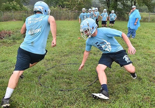 (Brad Davis/The Register-Herald) Meadow Bridge players work through agility drills during preseason football practice Wednesday afternoon.