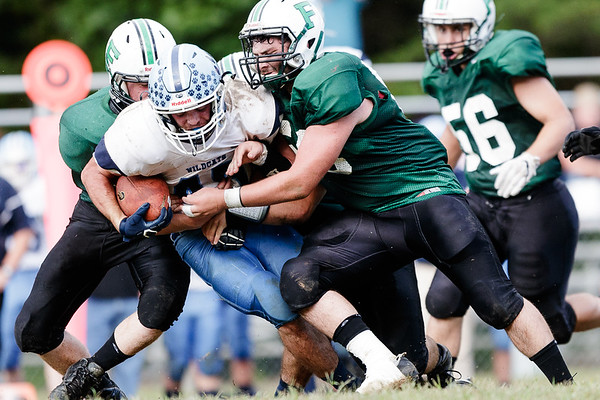 A gang of Fayetteville Pirates bring down Meadow Bridge's Caleb Richmond. Chad Foreman for the Register-Herald.