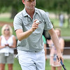 (Brad Davis/The Register-Herald) Webb Simpson waves to the crowd after making birdie on no. 11 during opening round action of the Military Tribute at The Greenbrier Thursday afternoon in White Sulphur Springs.