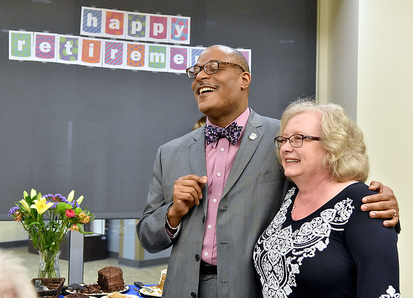(Brad Davis/The Register-Herald) Retiring New River Community and Technical College employee Libby Belcher shares a few laughs with the school's president, L. Marshall Washington, as he congratulates her on more than 20 years of service during a reception Wednesday afternoon.