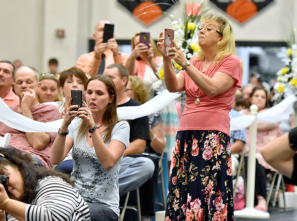 (Brad Davis/The Register-Herald) Family members snaps photos during Westside's 2018 commencement ceremony Sunday afternoon in Clear Fork.