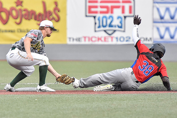 (Brad Davis/The Register-Herald) Miners shortstop Maddux Houghton makes the easy tag for an out on stealing Champion City baserunner Quincy Hamilton during the first game of a double header against Champion City Wednesday at Linda K. Epling Stadium.