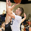 (Brad Davis/The Register-Herald) Shady Spring's Cole Honaker drives to the basket as Westside's Broc Smith defends Wedensday night in Shady Spring.