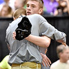 (Brad Davis/The Register-Herald) Fayetteville's Trent Pullens gets a hug from his coach Shaun Coleman after falling in a close match to Indy's Connor Gibson during State Wrestling Tournament action Saturday night at the Big Sandy Arena.