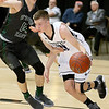 (Brad Davis/The Register-Herald) James Monroe's Remington Reese drives around Wyoming East's Caden Lookabill defends during Big Atlantic Classic action Wednesday night at the Beckley-Raleigh County Convention Center.