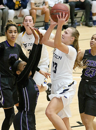 (Brad Davis/The Register-Herald) WVU Tech's Brittney Justice drives to the basket as Cincinnati Christian's Kamiylah Bomar defends Thursday night at the Beckley-Raleigh County Convention Center.