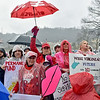 (Brad Davis/The Register-Herald) Teachers and service personnel from all over the state hold signs and make their voices heard as they brave the rain and cold in massive numbers during a rally Saturday afternoon at the State Capitol Complex.