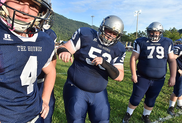 (Brad Davis/The Register-Herald) Valley senior lineman Jeremiah Pritt, middle, busts a few dance moves as he and teammates go through warmups Friday night in Smithers.