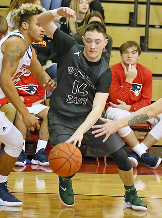 (Brad Davis/The Register-Herald) Wyoming East's Caden Lookabill cuts around Independence's Niko Burgess Friday night in Coal City.