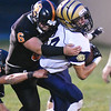 Shady Spring's Isaiah Valentine (44) is tackled by Summers County's Marcus McGuire (6) during their high school football game Friday in Hinton. (Chris Jackson/The Register-Herald)