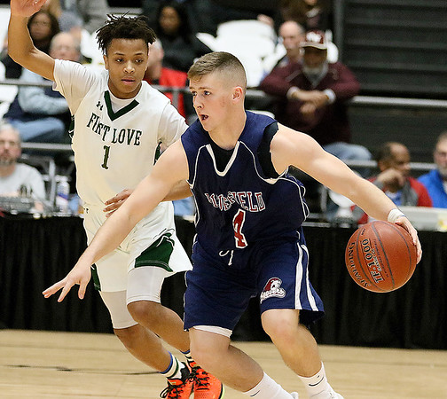 (Brad Davis/The Register-Herald) Bluefield's Chandler Cooper pushes up the court as First Love's Isaiah Wilson defends during the Little General Battle for the Armory Tournament Friday night at the Beckley-Raleigh County Convention Center.
