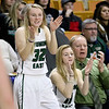 (Brad Davis/The Register-Herald) Wyoming East senior Gabby Lupardus, left, and freshman Skylar Davidson, both out with injuries, cheer on their Lady Warrior teammates during their State Tournament win over Wayne Friday morning at the Charleston Civic Center.