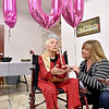 (Brad Davis/The Register-Herald) 100-year-old Helen Hawley talks about all she's seen over a century as a lifelong resident of Raleigh County while answering questions from local media with help from Granddaughter Penny Carrico during the opening moments of a much anticipated birthday party Saturday afternoon at Old Crow Baptist Church.