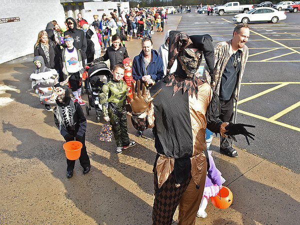 (Brad Davis/The Register-Herald) Ghoulish creatures, super heroes and various other strange characters progress through the line as hundreds visit Linda K. Epling Stadium for a Trunk or Treat event Sunday afternoon.