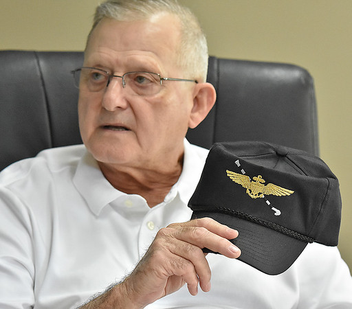 (Brad Davis/The Register-Herald) Retired Navy pilot Herbert Wheeler shows off a hat he wears frequently featuring the Navy wings with cable hook, symbolizing his status as a carrier lander. He has 187 combat missions in Vietnam between August 1968 and May 1970 to his credit to go along with seven and a half months in Desert Storm before retiring as a National Guard Wing Commander in Charleston in 2000. On his 199th mission in Vietnam, his plane went down in northern Laos. He was eventually rescued, but his co-pilot was taken prisoner and was ultimately one of only a handful of captured pilots out of hundreds in Laos to ever return home sometime later. He currently serves as VP of the board at the Raleigh County Airport.